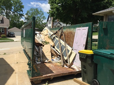 Get a rental dumpster with a gate for easy access